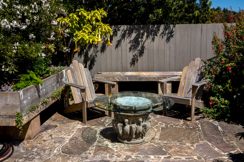 Garden - two chairs and a circular glass top table.