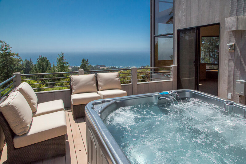 deck with hot tub and seating