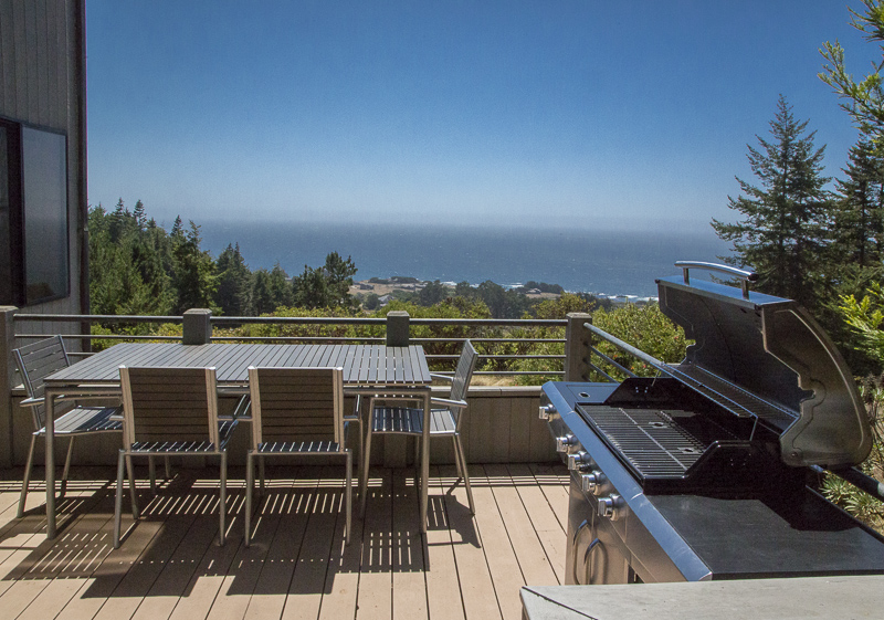 back deck with table, chairs and BBQ