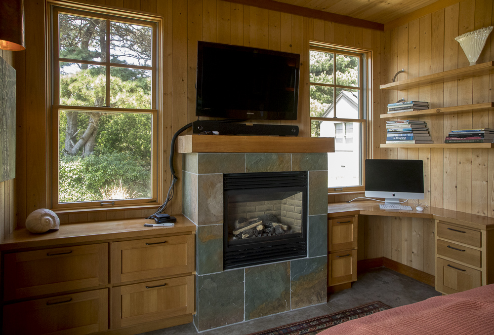 Fireplace wall with cabinets and computer screen