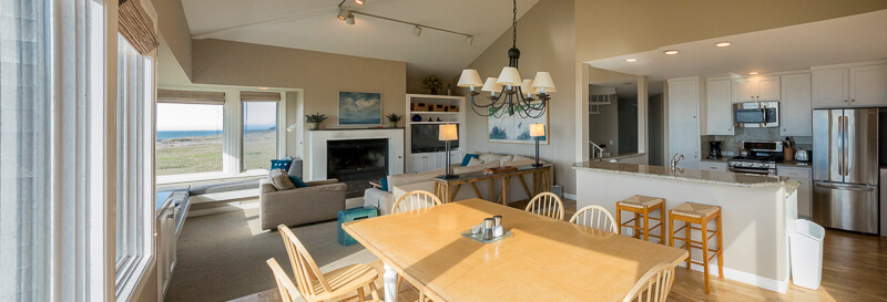 dining table with kitchen and living room