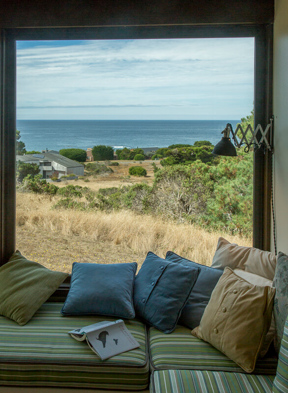 Window seat with view across the meadow to the ocean.