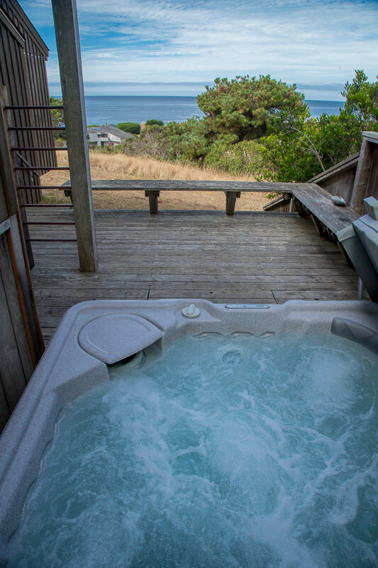 Hot tub on deck with view of ocean.