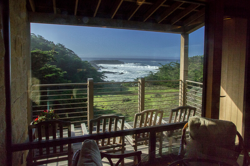 view across back deck to ocean from living room