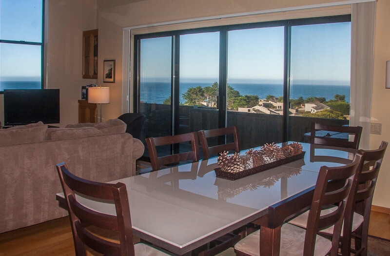 Dining room table, six chairs and view of ocean..