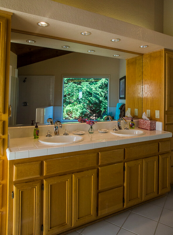 Bathroom with mirror and two sinks.