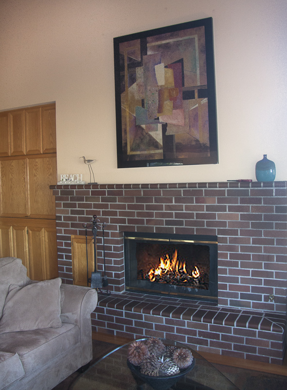 Fireplace with sofa and coffee table.