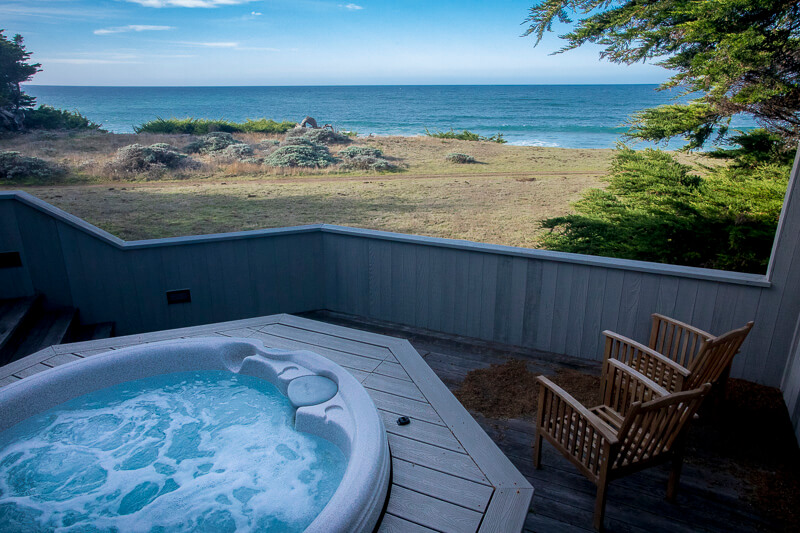 hot tub, two chairs with view of ocean