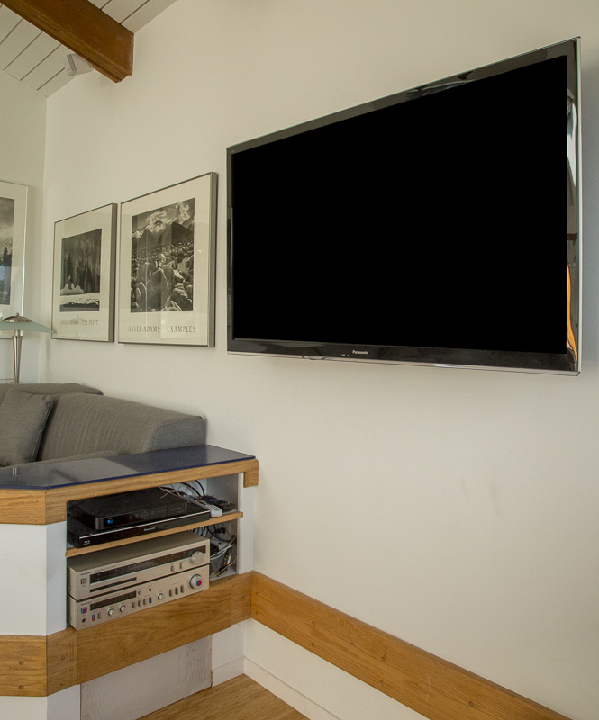 Wall mounted wide screen television.