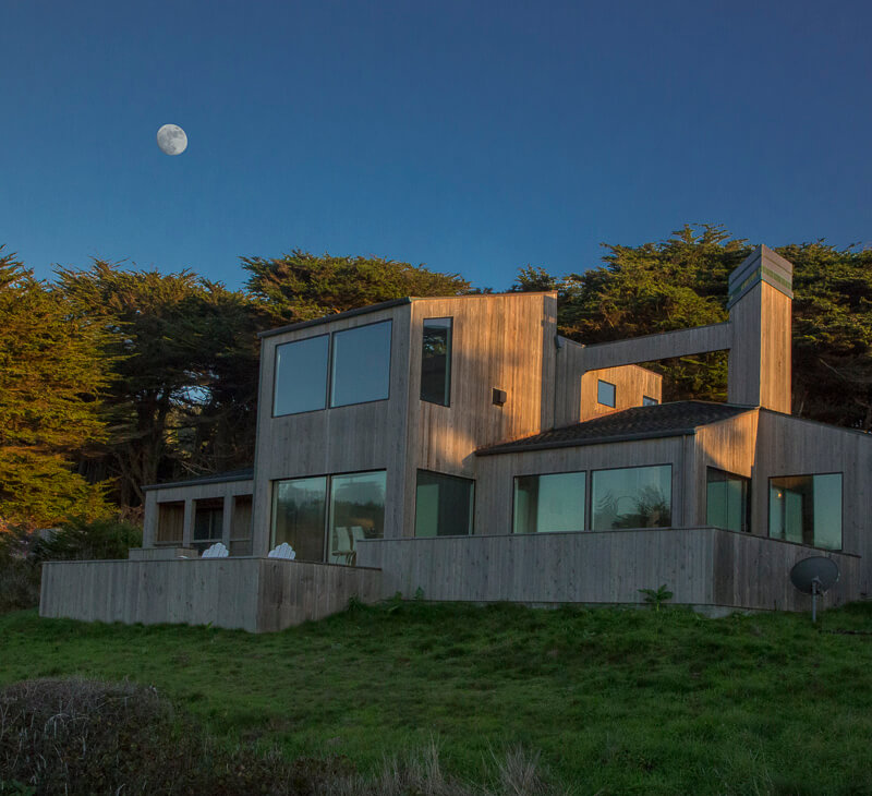 Exterior of home with moon above.