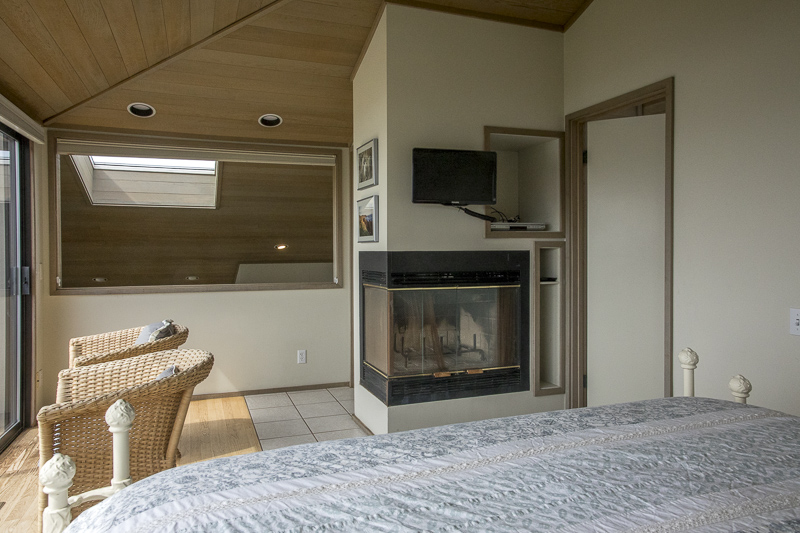 bedroom showing fireplace and television