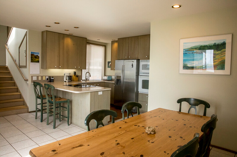 Dining table with kitchen beyond