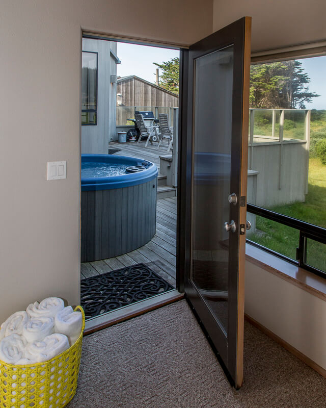 door to back deck with hot tub