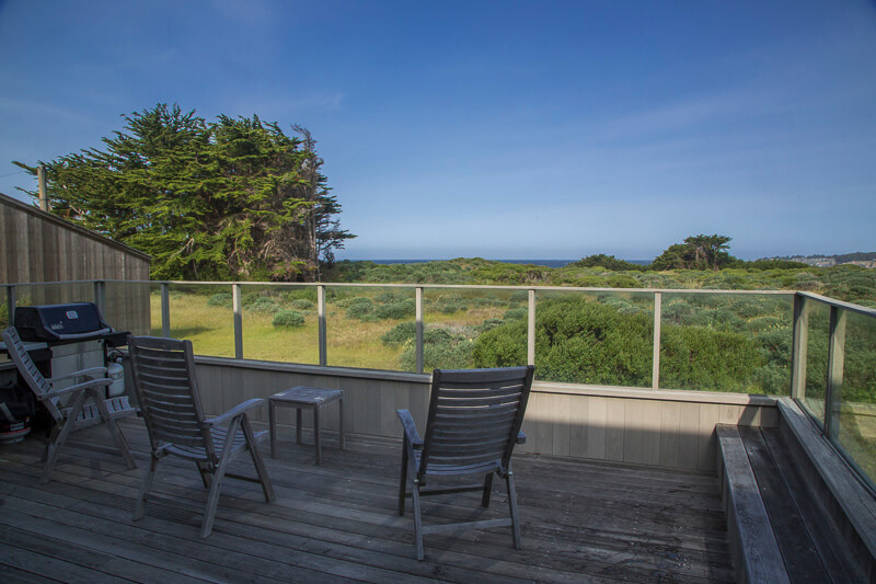 deck with view across meadow to ocean