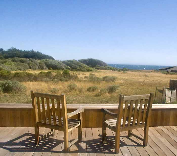 view from back deck across meadow to the ocean