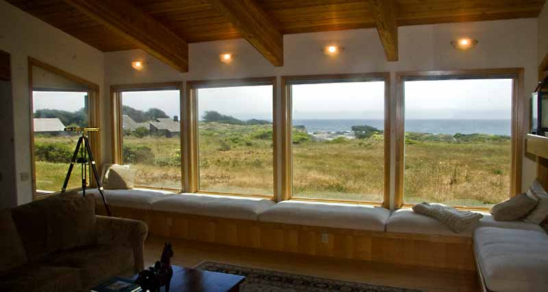 Living room - window seat with view across the meadow to the ocean.