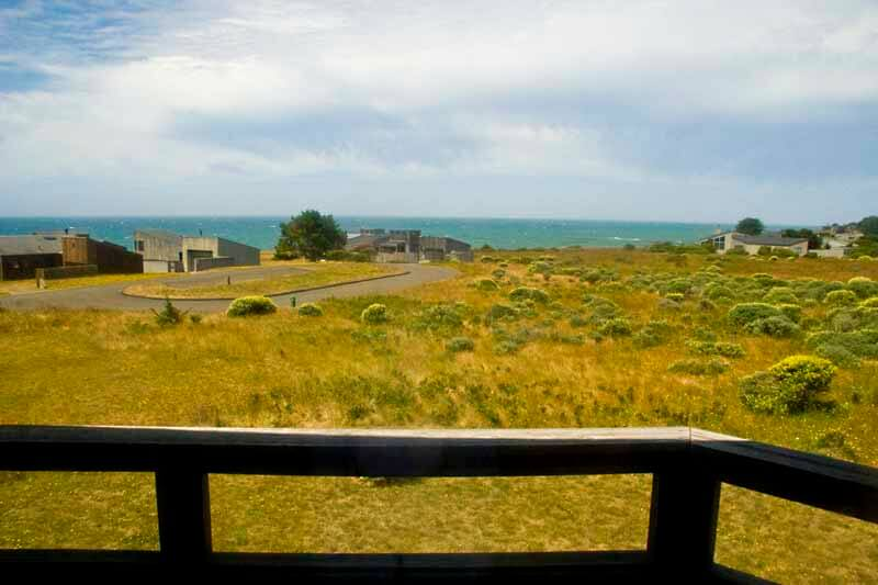View across the meadow to the ocean from the deck.