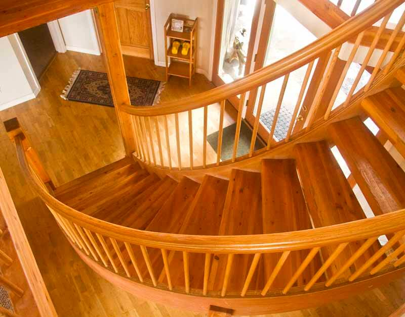 Curved stairway in the entry.