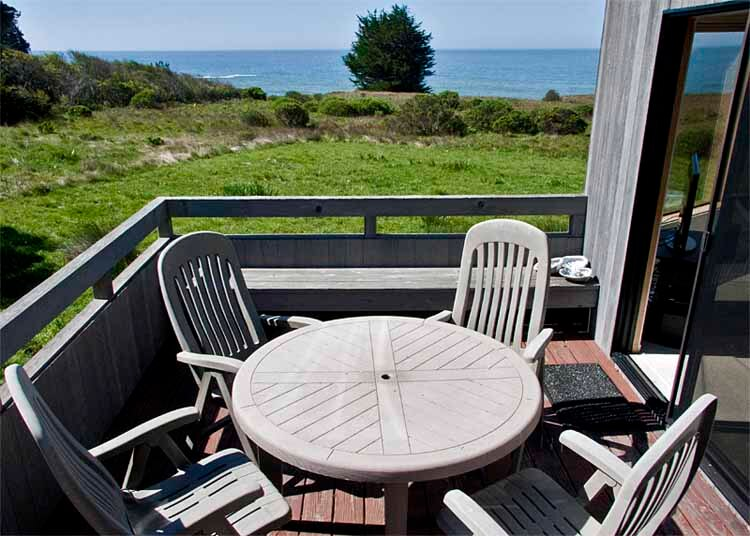 deck with table and four chairs