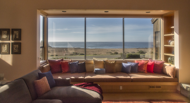 Living room window seat with ocean view.