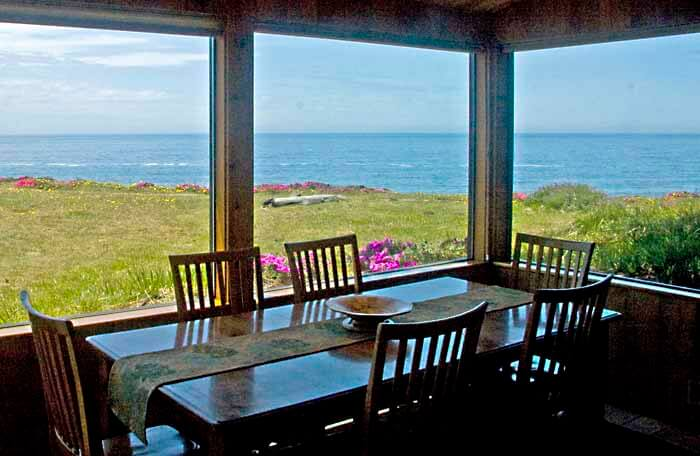 dining table with view of bluff in front of house