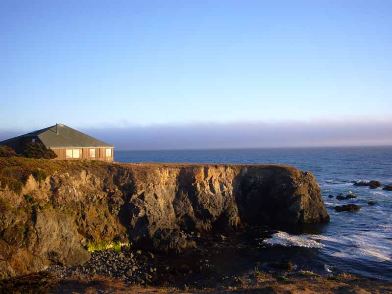 house on point of land overlooking ocean