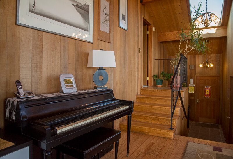 piano and stairs to bedroom