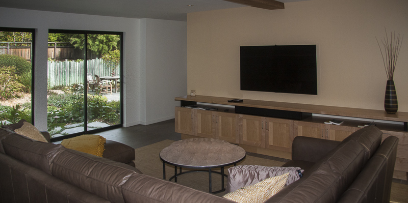 Television room showing seating and large screen television