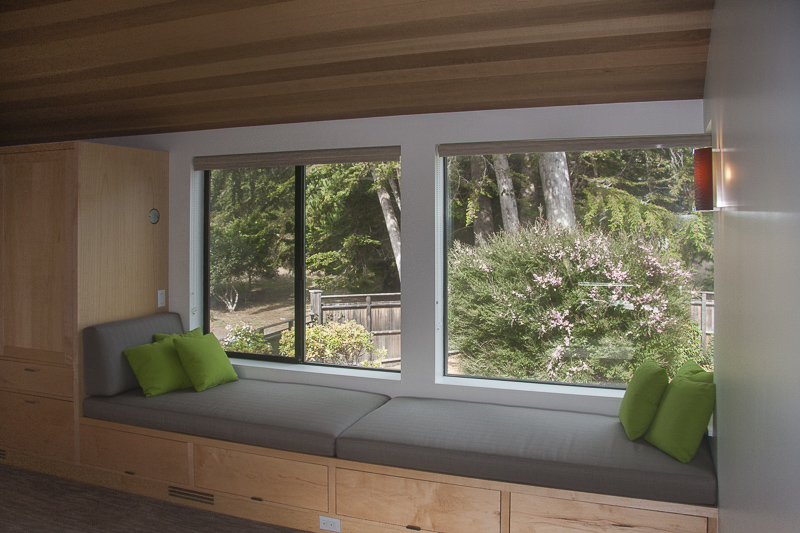 Window seating in bedroom with garden views