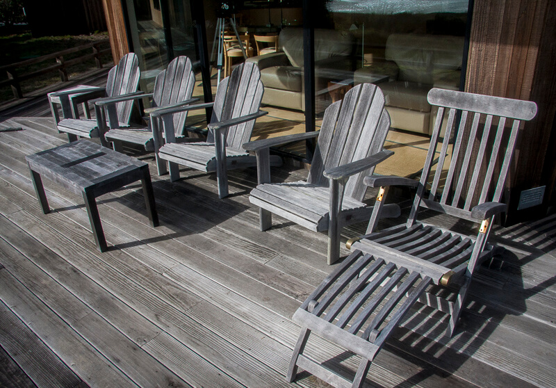 five chairs and a table on back deck
