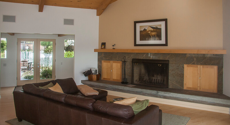living room with fireplace wall