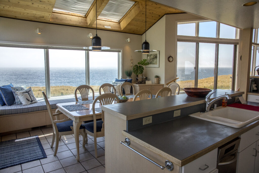 View from kitchen across dining room to ocean beyond