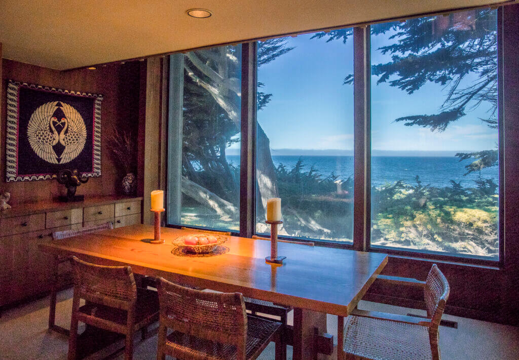 Dining table with view of ocean.