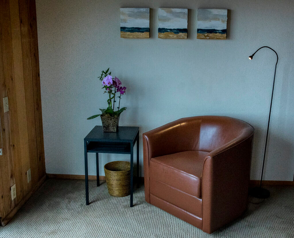 Chair and small table in master bedroom