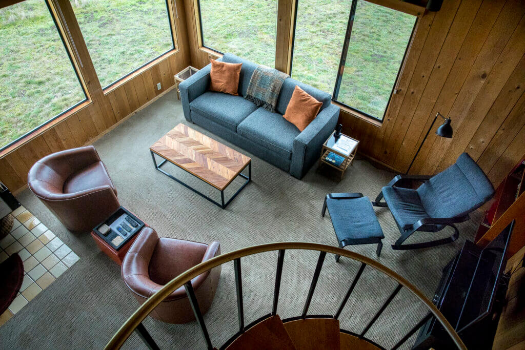 View of living room from circular stairway