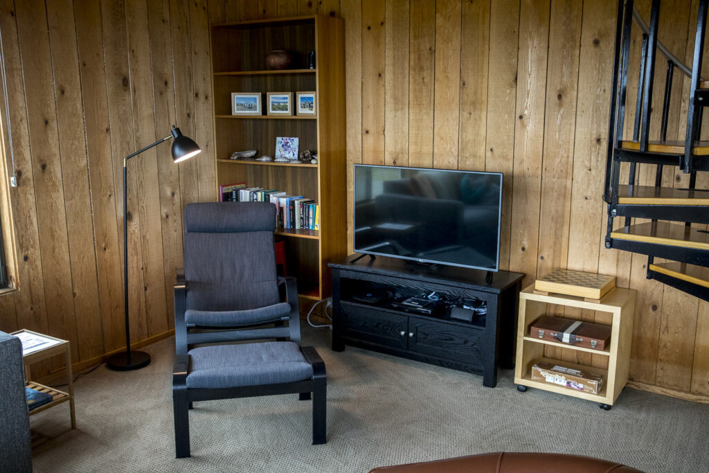 Television and chair with ottoman