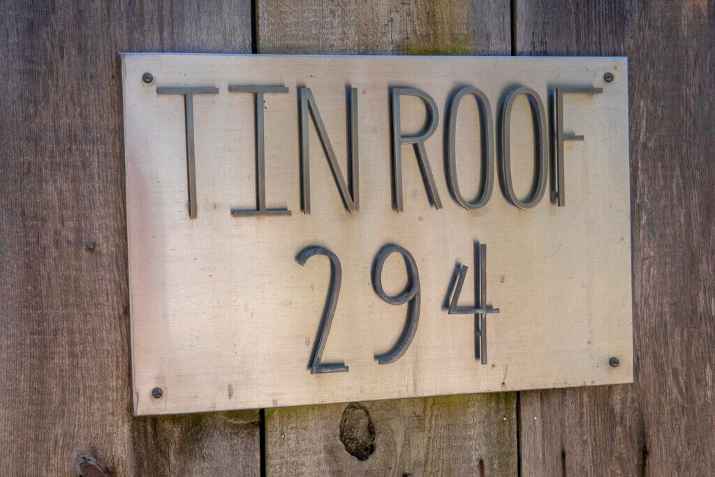 A sign that says Tin Roof 294.