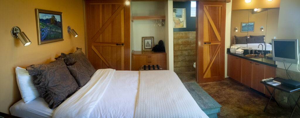 One of two guest bedrooms showing the bed and the sink.