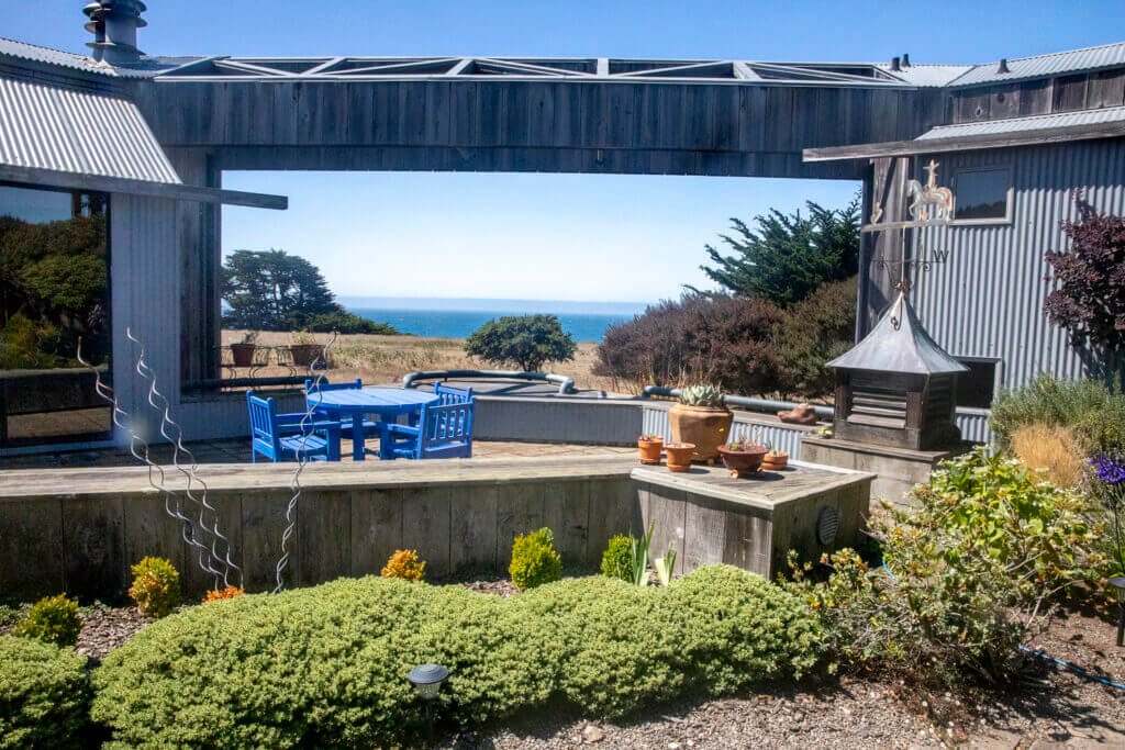 The enclosed garden with a view of the ocean.