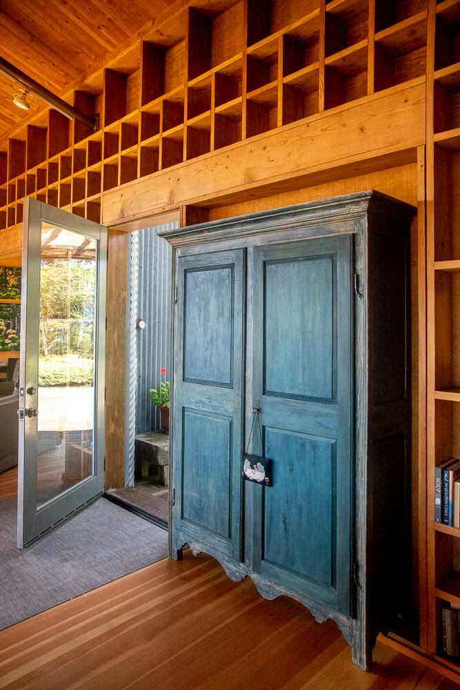 The front door and a cabinet from inside the home.