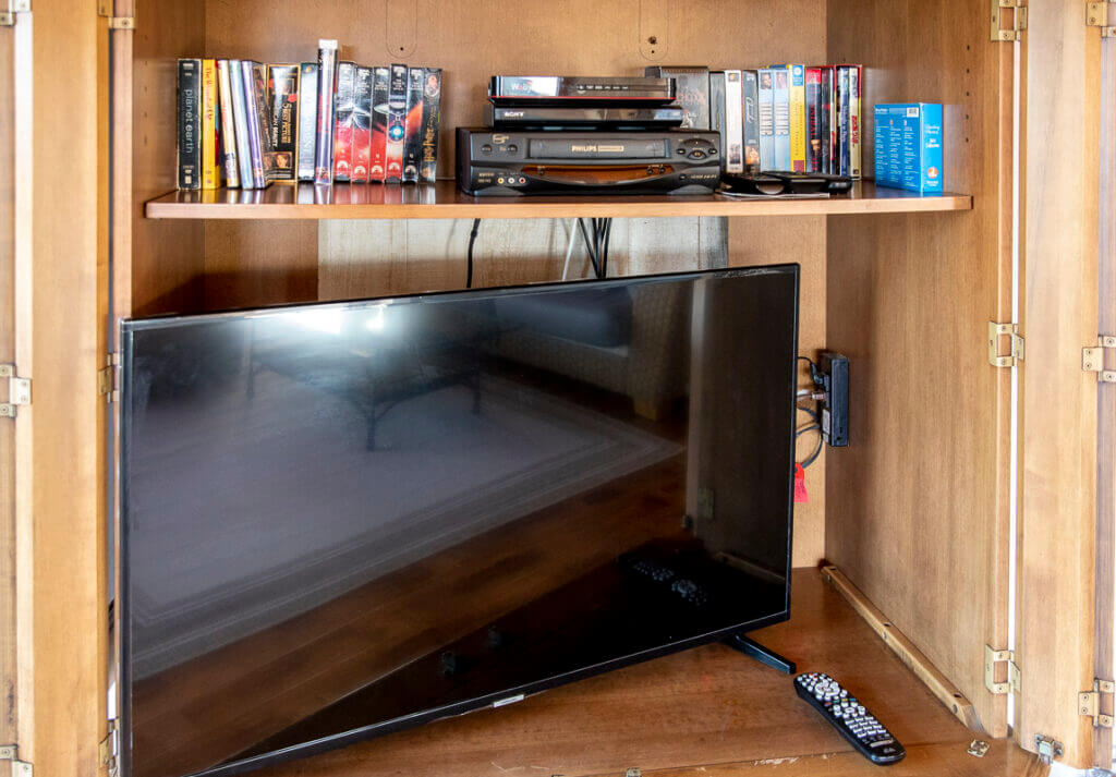 Large screen television in cabinet.
